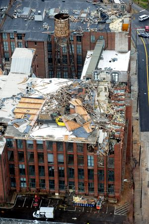 Cotton Mill Lofts. Roof was removed by the tornado and portions of the top floors collapsed all the way to the basement.
